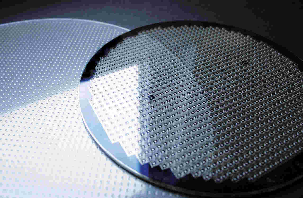 Photograph of lens wafer and a stacked wafer with fully functional optical modules